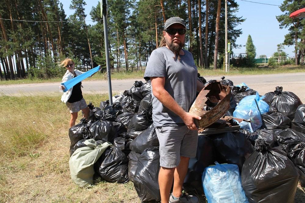 Привет из Новой Зеландии: бывший томич организовал уборку мусора на озере в Победе